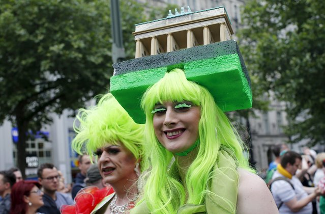 A participant wears a headpiece in the shape of the Brandenburg Gate at the annual Christopher Street Day parade on Kurfuerstendamm in Berlin, Germany, June 27, 2015. (Photo by Fabrizio Bensch/Reuters)