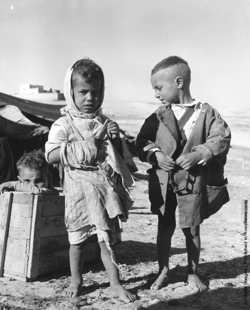 1955: Young Bedouin boys barefoot in the desert
