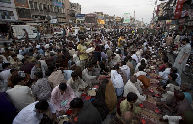 Pakistani devotees wait to to break the day's fast in Rawalpindi, Pakistan, Tuesday, June 30, 2015. Muslims across the world are observing the holy fasting month of Ramadan, where they refrain from eating, drinking and smoking from dawn to dusk. (Photo by B. K. Bangash/AP Photo)