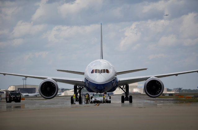 Workers check over the new Boeing 787-10 Dreamliner after it's first test flight at the Charleston International Airport in North Charleston, South Carolina, United States March 31, 2017. (Photo by Randall Hill/Reuters)