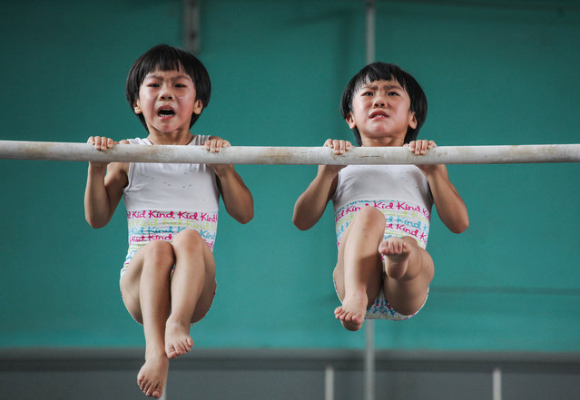 Sport category, winner: Yuan Peng. Liu Bingqing and Liu Yujie are twin sisters who have studied and trained in gymnastics since their early childhood in Jining, China. (Photo by Yuan Peng/Sony World Photography Awards)