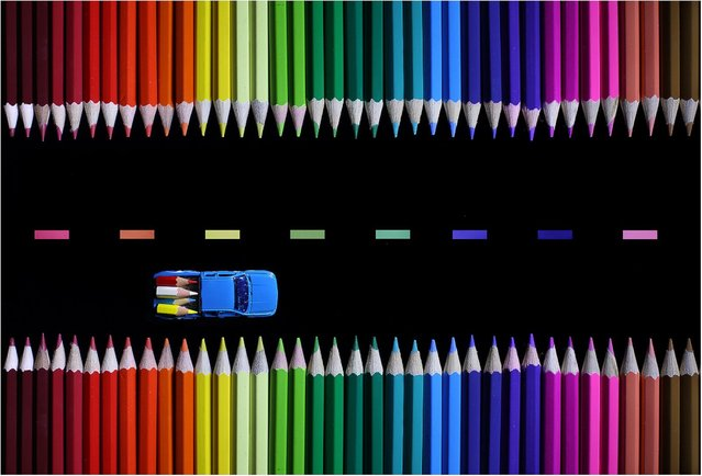 """Colored Pencil and Origami Landscapes: """"A toy truck lugs pencil tips down a colorful highway"""". (Photo by Victoria Ivanova)"""