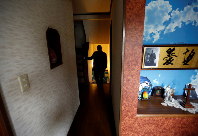 Seiichiro Nishimoto, CEO of Shelter Co., walks into a basement where the model room for the company's nuclear shelters is installed during an interview with Reuters in Osaka, Japan April 26, 2017. With nearby North Korea increasing its show of power day by day with missile launches and nuclear tests, people in Japan are preparing for the worst by building private nuclear shelters, Reuters reports. In Japan, small companies offering custom-built underground nuclear shelters claim a boost in sales in recent weeks. Oribe Seiki Seisakusho, based in Kobe, western Japan, told Reuters it typically receive six shelter-building orders a year, but has received eight orders in April alone. Another company, Earth Shift, says it has received 10 times more inquiries for quotes this year. A Reuters photographer recently took a tour of Shelter Co.'s sales model, built in the Osaka home of the company's CEO, Seiichiro Nishimoto. The air-tight basement features an anti-blast door, an anti-radiation air purifier, a tunnel exit, a Geiger counter, a television, gas masks, and other emergency supplies. Perhaps anticipating that residents confined underground would like to be reminded of a peaceful radiation-free world, the shelter's ceiling is painted in bright blue skies, and has wallpaper depicting a tropical palm tree-lined beach. Nishimoto claimed in a 2009 interview with AFP that his business had seen a record number of sales in the days between the announcement and launch of a North Korean intercontinental ballistic missile over Japan at the time. (Photo by Kim Kyung-Hoon/Reuters)