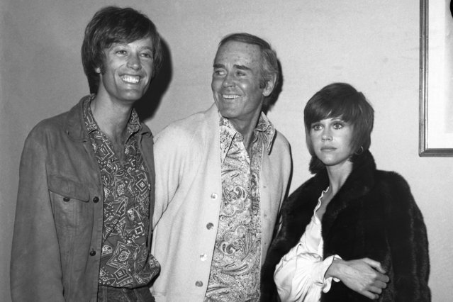 """Actor Henry Fonda (center), currently starring in a revival of """"Our Town"""", meets with son Peter (left) and daughter Jane after they attended a recent performance of his play at the ANTA Theaters on Broadway, 1969. The two younger Fondas have also starred on stage and screen.  It was the first meeting in months for the talented trio. (Photo by Bettmann Archive/Getty Images)"""