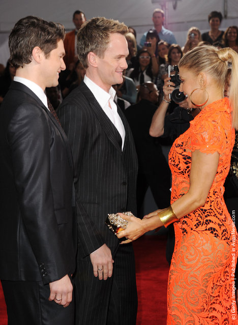 (L-R) David Burtka, actor Neil Patrick Harris and singer Fergie arrive at the 54th Annual GRAMMY Awards held at Staples Center