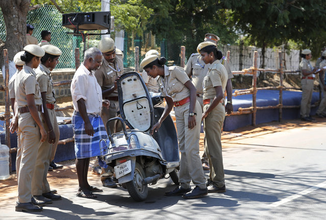 Police officers check a vehicle at the entrance to Mamallapuram, where Indian Prime Minister Narendra Modi and Chinese President Xi Jinping will hold their first meeting and dinner in southern India, Friday, October 11, 2019. Xi is coming to India to meet with Modi on Friday, just weeks after Beijing supported India's rival Pakistan in raising the issue of New Delhi's recent actions in disputed Kashmir at the U.N. General Assembly meeting. (Photo by Manish Swarup/AP Photo)