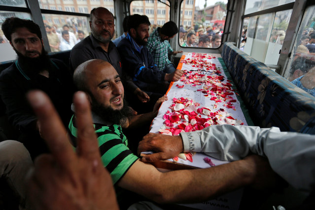 Relatives and friends transport the remains of one of three police officers shot dead at point-blank range in Srinigar, India May 23, 2016. (Photo by Danish Ismail/Reuters)