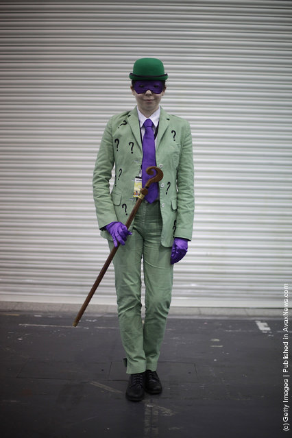 A visitor to the London Super Comic Convention dresses as The Riddler at ExCel