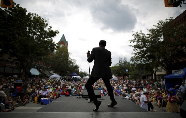 "Elvis Presley tribute artist Joey Cundari of Brampton, Ontario performs ""Jailhouse Rock"" on a street stage at the four-day Collingwood Elvis Festival in Collingwood, Ontario July 25, 2015. Featuring over 120 Elvis tribute artists, it is the world's largest Elvis festival and last year hosted 30,000 visitors. (Photo by Chris Helgren/Reuters)"
