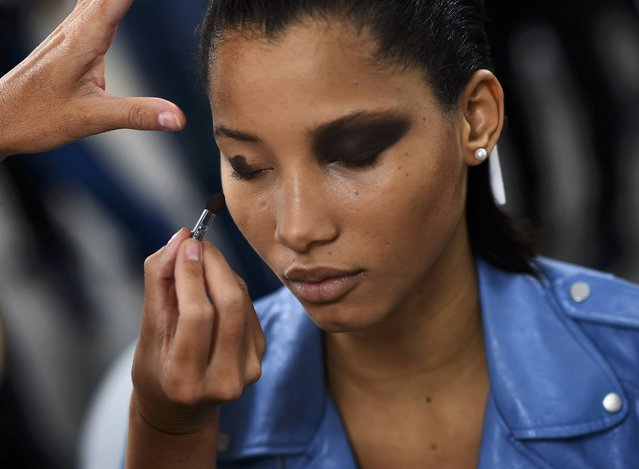 A model has her make-up applied inside Blenheim Palace ahead of a fashion show presenting the Dior, Cruise 2017 Collection, in Woodstock, Britain May 31, 2016. (Photo by Dylan Martinez/Reuters)