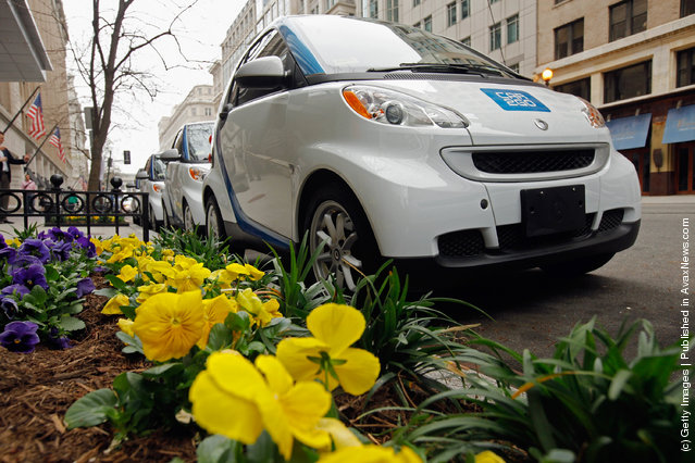 Car2go  vehicles are lined up for display March 22, 2012 in Washington, DC
