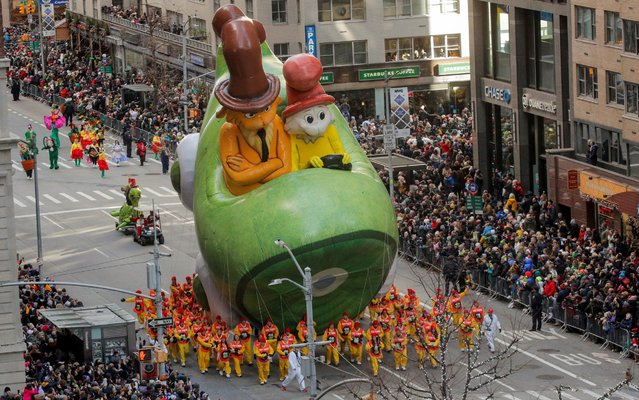 Dr. Seuss' Green Eggs and Ham balloon hovers above the crowd during the 93rd Macy's Thanksgiving Day Parade in Manhattan,New York, U.S., November 28, 2019. (Photo by Brendan Mcdermid/Reuters)