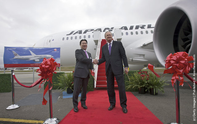 President and CEO of Japan Airlines Yoshiharu Ueki, left, shakes hands with Boeing Commercial Airplanes President Jim Albaugh after cutting the ribbon to celebrate the first delivery 787 to Japan Airlines at the Paine Field in Everett, Washington
