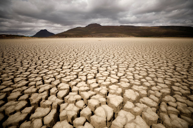Clouds gather but produce no rain as cracks are seen in the dried up municipal dam in drought-stricken Graaff-Reinet, South Africa, November 14, 2019. (Photo by Mike Hutchings/Reuters)