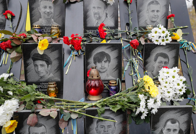 Flowers and candles are seen at the memorial for Maidan activists or 'Heroes of the Heavenly Hundred', who were killed on the Maidan during anti-government protests in 2014, not far from Independence Square in Kiev, Ukraine, 21 November 2019. Ukrainians marked the anniversary of the Euromaidan revolution, commemorating 21 November 2013, on which activists started an anti-government picket after then-Prime Minister Mykola Azarov announced the suspension of a landmark treaty with the European Union. The protests eventually led to the ouster of President Viktor Yanukovych, creating political rifts through the country that erupted into a violent conflict between separatists and government forces in the eastern part of the country in the spring. (Photo by Sergey Dolzhenko/EPA/EFE)