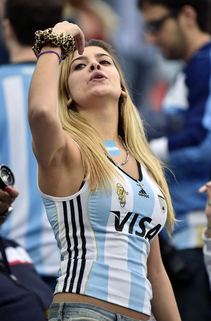 An Argentina supporter gestures before the World Cup semifinal soccer match between the Netherlands and Argentina at the Itaquerao Stadium in Sao Paulo Brazil, Wednesday, July 9, 2014. (Photo by Martin Meissner/AP Photo)