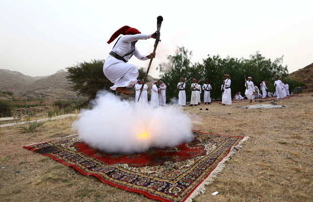 A man fires a weapon as he dances during a traditional excursion near the western Saudi city of Taif, August 8, 2015. (Photo by Mohamed Al Hwaity/Reuters)