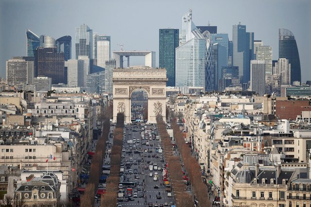 General view of the skyline of La Defense business district with its Arche behind Paris' landmark, the Arc de Triomphe and the Champs Elysees Avenue in Paris, France, January 13, 2016. (Photo by Charles Platiau/Reuters)