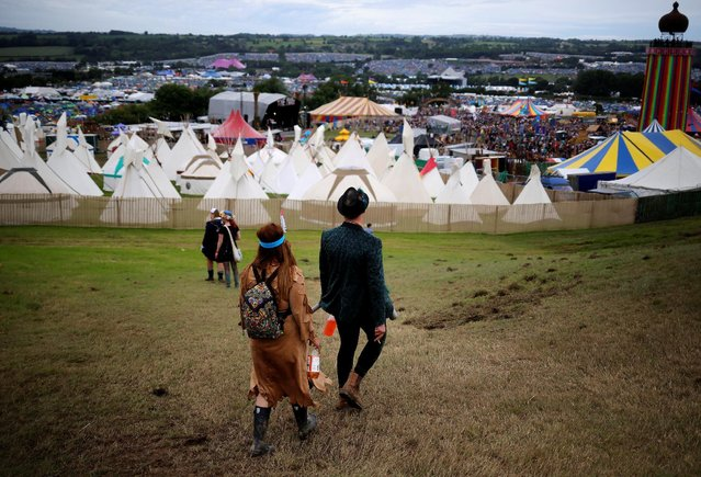 Revellers walk near The Park stage during the Glastonbury Festival at Worthy Farm in Somerset, Britain, June 23, 2016. (Photo by Stoyan Nenov/Reuters)