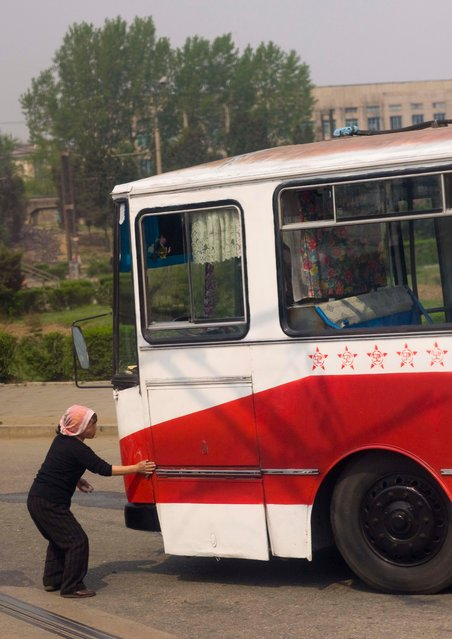It is forbidden to enter Pyongyang with a dirty car, so after a long trip on the highway, the cars are the buses are cleaned before entering the town. It is a way to respect the town of the Leaders told my guide. (Photo by Eric Lafforgue/Exclusivepix Media)