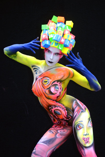 A model poses with her bodypainting designed by bodypainting artist Benoit Botalla from Guadeloupe, in the 2016 World Bodypainting Festival, 2016 in Poertschach am Woerthersee, Austria. (Photo by Didier Messens/Getty Images)
