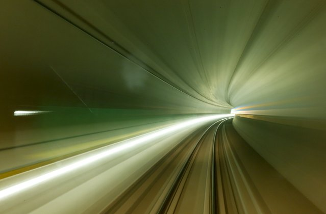 A long exposure is taken from a train driving through the NEAT Gotthard Base Tunnel during a media visit near the town of Sedrun August 24, 2015. (Photo by Arnd Wiegmann/Reuters)