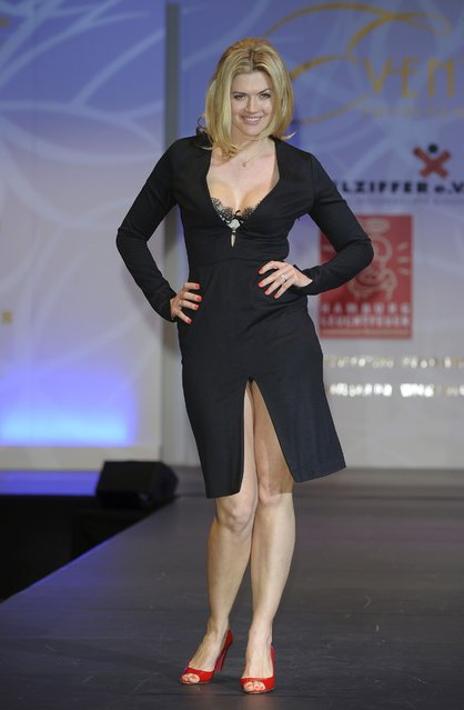 """German actress Nina Bott shows designs on the catwalk during the charity event """"Event Prominent"""" at the Hotel Grand Elysee on March 25, 2012 in Hamburg, Germany.  (Photo by Christian Augustin/Getty Images)"""