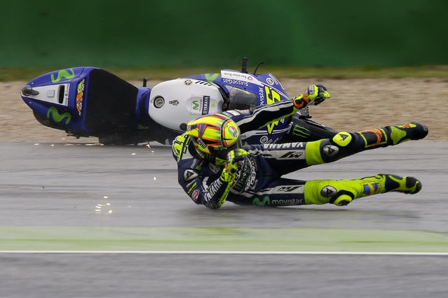 Yamaha MotoGP rider Valentino Rossi of Italy crashes during the first free practice session of the Italian Grand Prix at the Misano Adriatico circuit in central Italy September 12, 2014. (Photo by Max Rossi/Reuters)