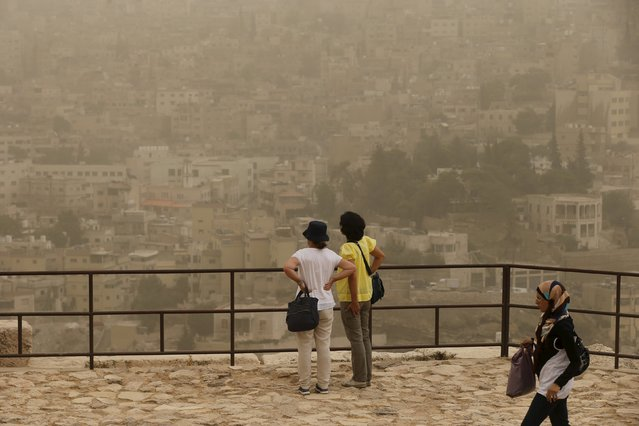 Tourists inspect the view at the Amman Citadel, during a sandstorm in downtown Amman, Jordan, September 8, 2015. (Photo by Muhammad Hamed/Reuters)