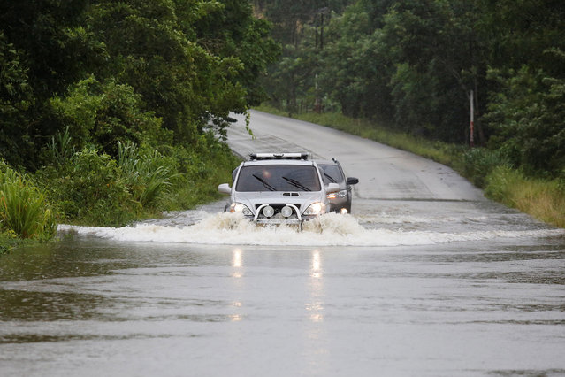 Vehicles travel through a flooded road in the aftermath of Hurricane Earl, in Peten, Guatemala, August 4, 2016. (Photo by Luis Echeverria/Reuters)