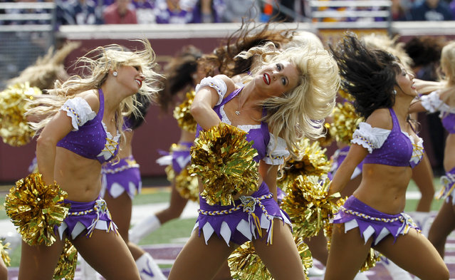 Minnesota Vikings cheerleaders perform during the first half of an NFL football game against the New England Patriots in Minneapolis Sunday, September 14, 2014. (Photo by Ann Heisenfelt/AP Photo)