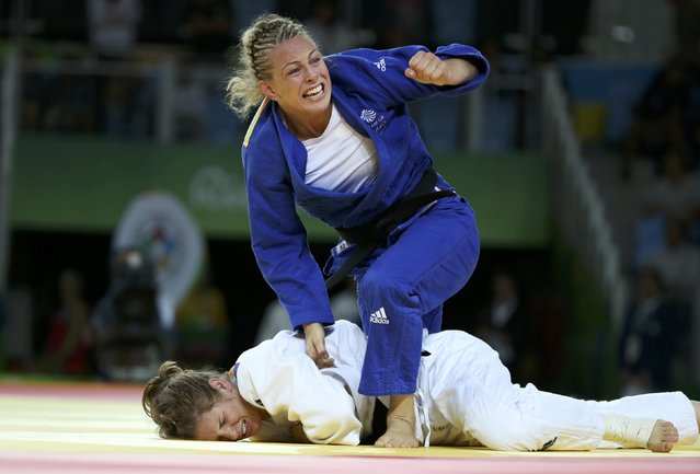 2016 Rio Olympics, Judo, Final, Women, 70 kg Bronze Medal Contests, Carioca Arena 2, Rio de Janeiro, Brazil on August 10, 2016. Sally Conway (GBR) of Britain celebrates winning the bronze medal as Bernadette Graf (AUT) of Austria reacts. (Photo by Toru Hanai/Reuters)