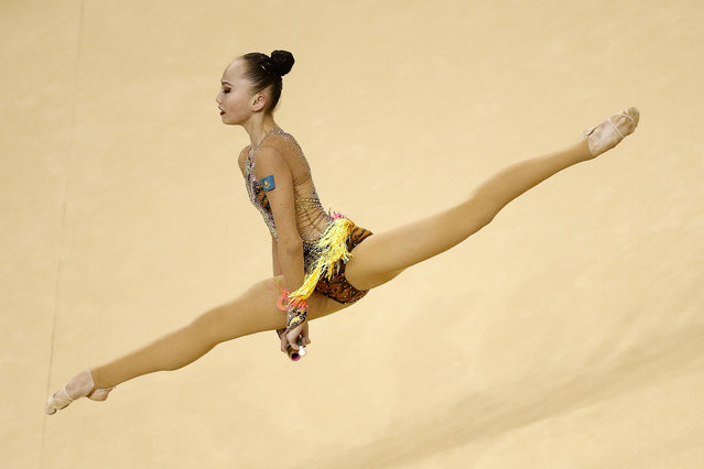 Kazakhstan's Sabina Ashirbayeva participates in the Individual All-Around Qualification round of the Rhythmic Gymnastics test event at the Olympic Arena, in Rio de Janeiro, Brazil, 21 April 2016. (Photo by Marcelo Sayao/EPA)