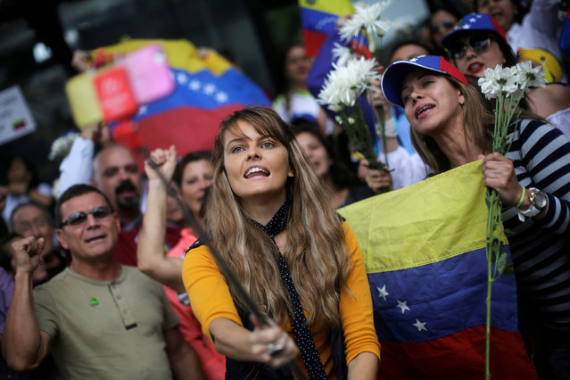 Venezuelans living in Guatemala take part in a protest to demand a referendum to remove Venezuela's President Nicolas Maduro, outside the Venezuela embassy in Guatemala City, Guatemala, September 1, 2016. (Photo by Saul Martinez/Reuters)