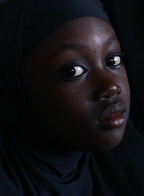 A young Muslim girl attends a Quranic lesson in a one-room madrasa in the Dar es-Salam neighborhood of Bouake, the former rebel capital of northern Ivory Coast, Tuesday, November 2, 2010. (Photo by Rebecca Blackwell/AP Photo)