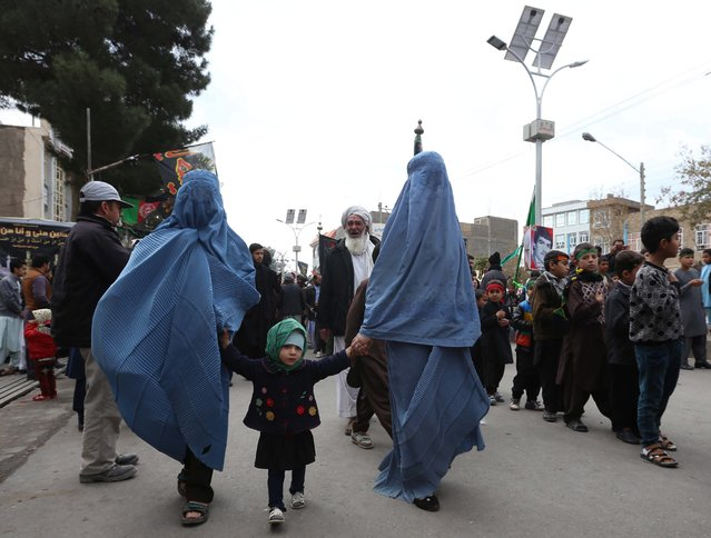 Afghani Shi'ite Muslims devotees attend a mourning procession commemorating Ashura, in Herat, Afghanistan, 3 November 2014. Muslims across the world are observing Moharram, the first month of Islamic calender, the climax of Moharram is the Ashura festival commemorating the martyrdom of Imam Hussein a grandson of the Prophet Mohammed in the Iraqi city of Karbala in the seventh century. (Photo by Jalil Rezayee/EPA)