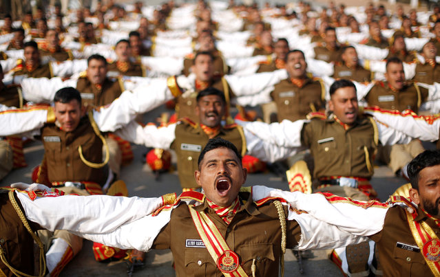 Soldiers take part in a laughter yoga session during their rehearsal for the Republic Day parade on a winter morning in New Delhi, January 11, 2018. (Photo by Adnan Abidi/Reuters)