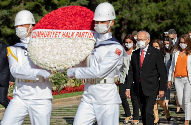 Turkey's main opposition Republican People's Party leader Kemal Kilicdaroglu, right, and newly elected executive committee members wearing face masks to protect against the spread of coronavirus, follow a military honour guard as they visit the mausoleum of modern Turkey's founder Mustafa Kemal Ataturk, in Ankara, Turkey, Saturday, August 8, 2020. (Photo by AP Photo/Stringer)