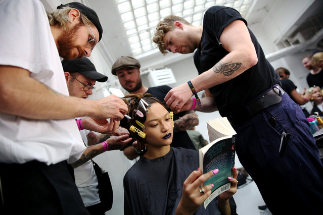 A model is styled backstage of the Fyodor Golan presentation during London Fashion Week Spring/Summer 2017 in London, Britain September 19, 2016. (Photo by Neil Hall/Reuters)