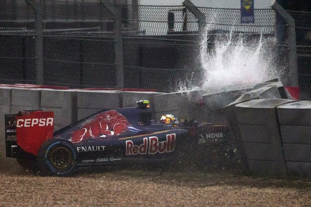 Toro Rosso driver Carlos Sainz Jr of Spain crashes while qualifying for the U.S. F1 Grand Prix at the Circuit of The Americas in Austin, Texas October 25, 2015. Sainz safely exited the vehicle. (Photo by Adrees Latif/Reuters)