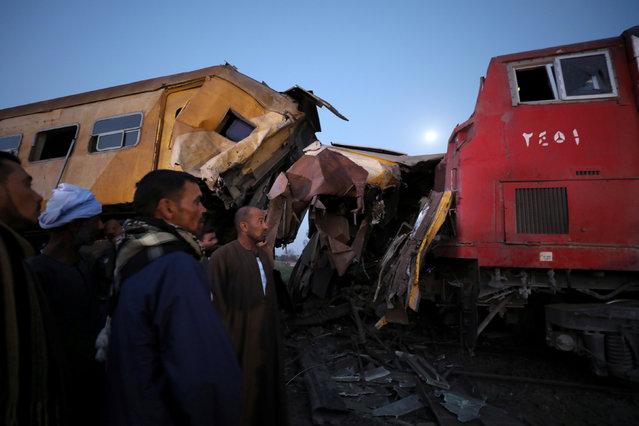 Rescue workers look at the wreckage after a train crash in Kom Hamada in the northern province of Beheira, Egypt, February 28, 2018. (Photo by Mohamed Abd El Ghany/Reuters)