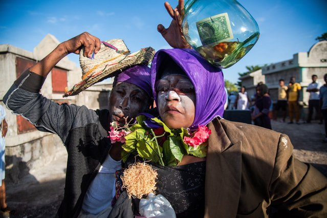 People visit a cemetery during the celebrations of the Guede, the traditional festival of the dead and one of the main festivities of voodoo, in Port-au-Prince, Haiti, 01 November 2020. (Photo by Jean Marc Herve Abelard/EPA/EFE)