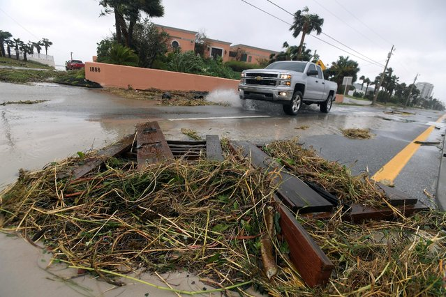 A motorist maneuvers around debris on the road after the eye of Hurricane Matthew passed Daytona Beach, Florida, U.S., October 7, 2016. (Photo by Phelan Ebenhack/Reuters)