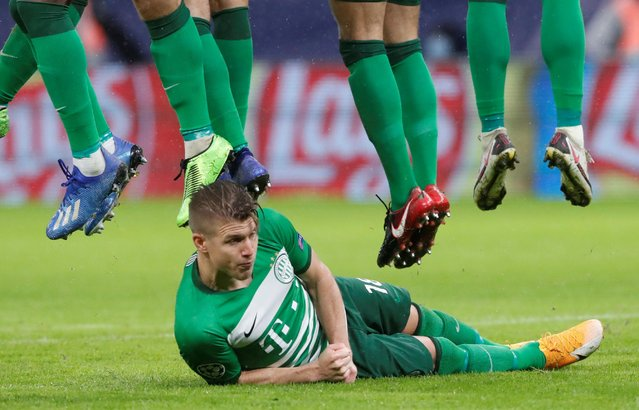 Ferencvaros's David Siger lies on the ground to defend a free kick during the UEFA Champions League Group Stage match between Ferencvarosi TC and Juventus at Puskas Arena on November 4, 2020 in Budapest, Hungary. (Photo by Bernadett Szabo/Reuters)