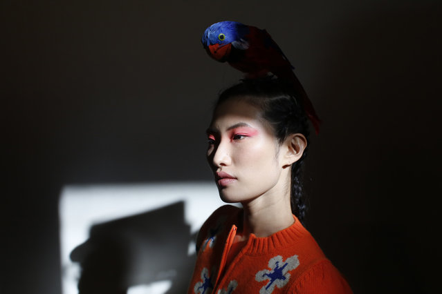 A model waits backstage before Shimada ready-to-wear fall/winter 2018/2019 fashion collection presented in Paris, Tuesday March 6, 2018. (Photo by Thibault Camus/AP Photo)
