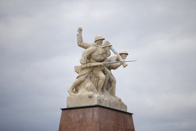 A sculpture representing three World War I soldiers in an attack position is seen on top of the Navarin monument, a pyramid inaugurated at Sommepy-Tahure in 1924 to pay tribute to World War I soldiers killed in Champagne, eastern France, November 3, 2015. From R to L; Quentin Roosevelt, son of former American President, the General Gouraud, head of the IVth army and the sculptor's brother who died at the Moulin of Laffaux. (Photo by Charles Platiau/Reuters)