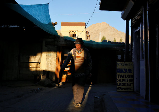 A man walks past shops as the sun sets in Leh, the largest town in the region of Ladakh, nestled high in the Indian Himalayas, India September 29, 2016. (Photo by Cathal McNaughton/Reuters)