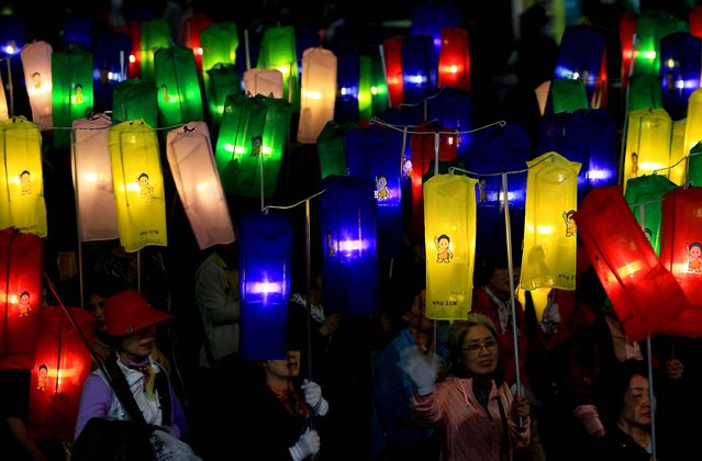 Preparing for the buddha's birthday, people march through the streets of Seoul. (Photo by Chung Sung-Jun/Getty Images)
