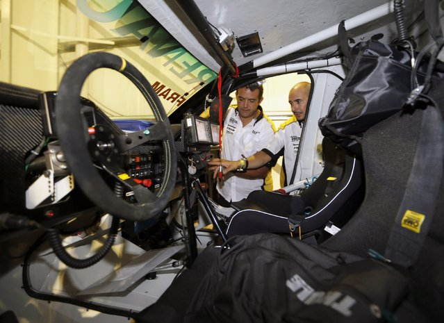 Argentine pilot Jose Garcia (L) and his navigator Mauricio Milano check their Renault while await technical verification ahead of the Dakar Rally 2015 in Buenos Aires January 1, 2015. (Photo by Enrique Marcarian/Reuters)
