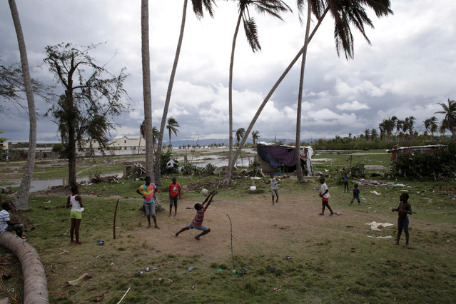 Children play football in an area affected by Hurricane Matthew in Les Cayes, Haiti, October 20, 2016. (Photo by Andres Martinez Casares/Reuters)